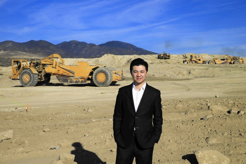John Ho, chief executive of Chinese home builder Landsea's U.S. subsidiary, stands at the Lake Forest site where the company plans to develop a 550-home community.