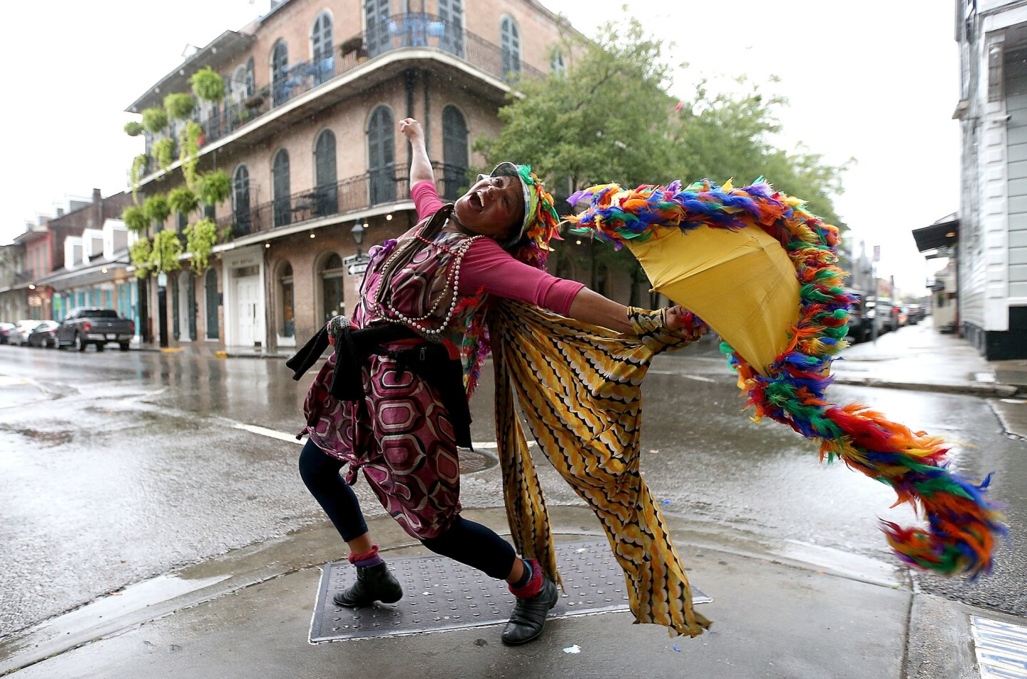 This year New Orleans turns 300, and nobody celebrates like this city. A woman dances on a French Quarter street in October 2017, just before Hurricane Nate made landfall.