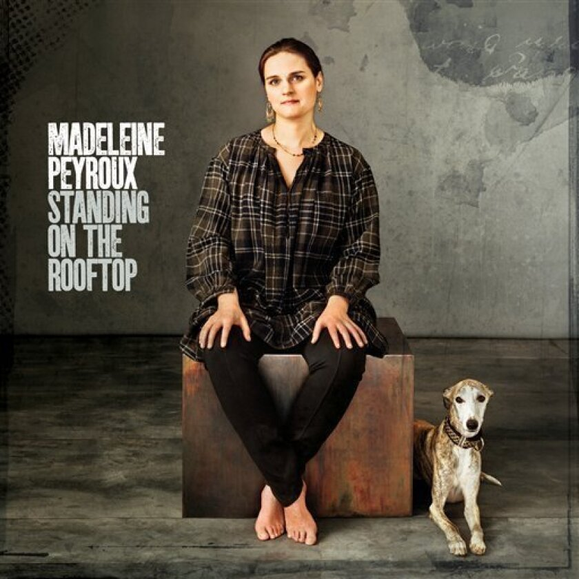 """In this CD cover image released by Emarcy/Decca, the latest release by Madeleine Peyroux, """"Standing on the Roodtop,"""" is shown. (AP Photo/Emarcy/Decca)"""