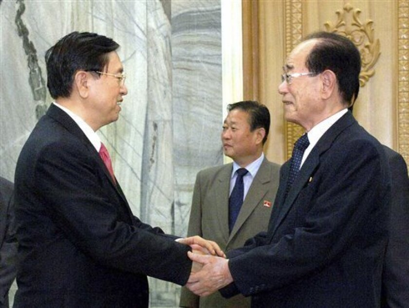 In this photo released by Korean Central News Agency and distributed by Korea News Service in Tokyo, Chinese Vice Premier Zhang Dejiang, left, is welcomed by Kim Yong Nam, president of the Presidium of the Supreme People's Assembly of North Korea, for a meeting in Pyongyang, North Korea, Tuesday, July 12, 2011. (AP Photo/Korean Central News Agency via Korea News Service) JAPAN OUT UNTIL 14 DAYS AFTER THE DAY OF TRANSMISSION