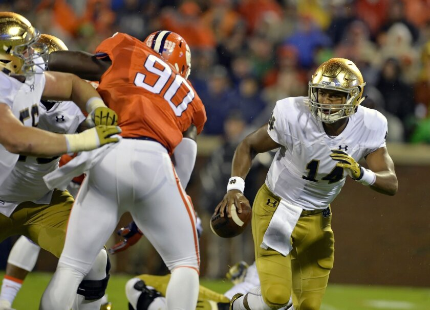 FILE- In this Oct. 3, 2015, file photo, Notre Dame quarterback DeShone Kizer, right, scrambles out of the pocket while pressured by Clemson's Shaq Lawson during the first half of an NCAA college football game in Clemson, S.C. The College Football Playoff committee will release its first rankings of