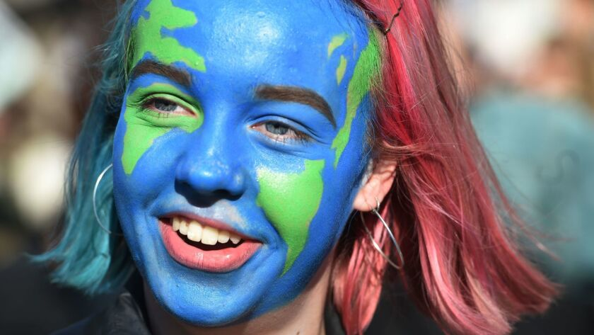 A student with her face painted participates in a climate change protest organized by 'Youth Strike 4 Climate' in London on Feb. 15.