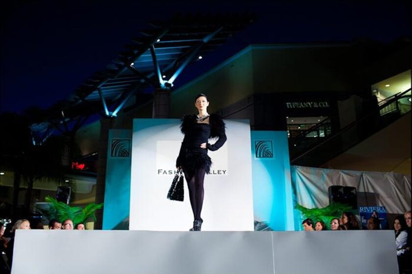 A model walks the runway at a recent fashion show in Fashion Valley. The San Diego mall will have runway fashion shows as part of Fashion's Night Out Sept. 6.