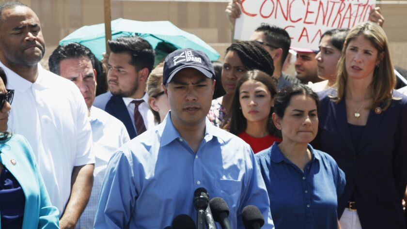 Rep. Joaquin Castro speaks alongside members of the Hispanic Caucus after touring inside of the Bord