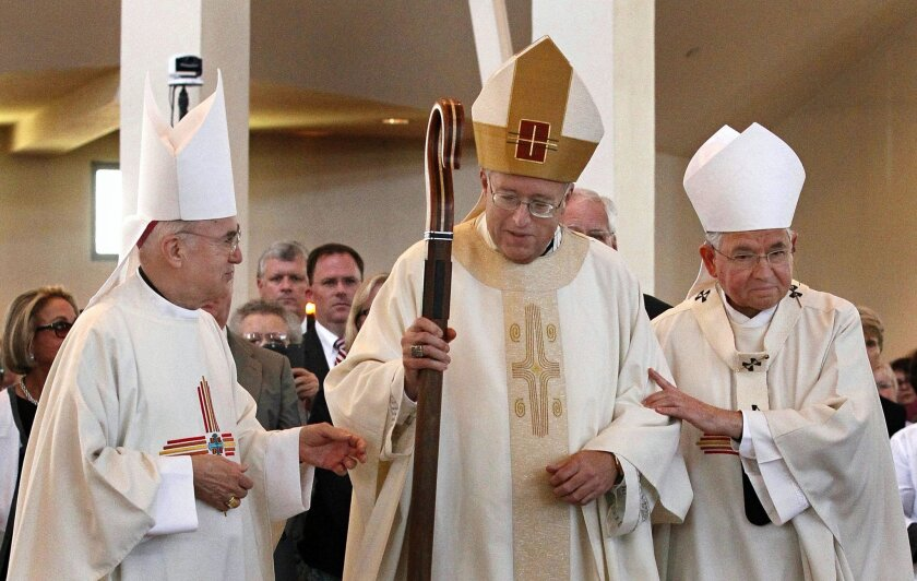 Newly-installed Bishop Robert McElroy (ctr.) walks with Archbishop Carlo Maria Vigano (left) and Archbishop Jose Horacio Gomez during the installation of McElroy as the sixth Bishop of San Diego at St. Therese of Carmel Church on Wednesday.