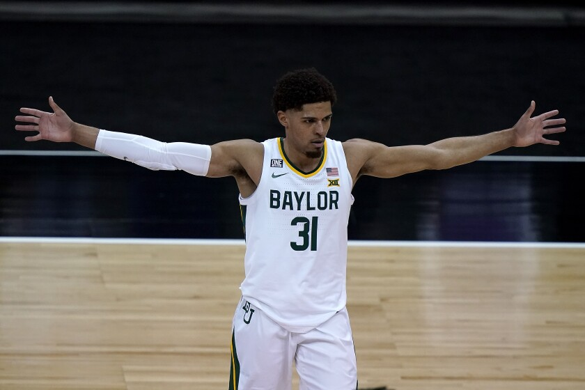 Baylor's MaCio Teague gathers his teammates for a meeting during the second half of an NCAA college basketball gameagainst Kansas State in the second round of the Big 12 Conference tournament in Kansas City, Mo., Thursday, March 11, 2021. Baylor won 74-68. (AP Photo/Charlie Riedel)