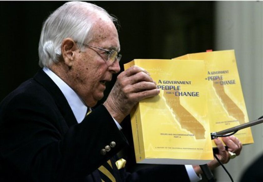 State Sen. Dave Cox, R-Fair Oaks, holds up copies of Gov. Arnold Schwarzenegger's California Performance Review, calling on lawmakers to revisit the documents in search of ways to cut the state budget during a joint special session of the Legislature to deal with the growing budget deficit Monday,