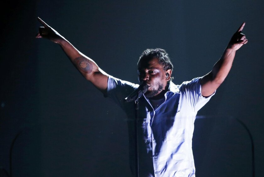 Kendrick Lamar performs a medley of songs at the 58th Grammy Awards in Los Angeles.