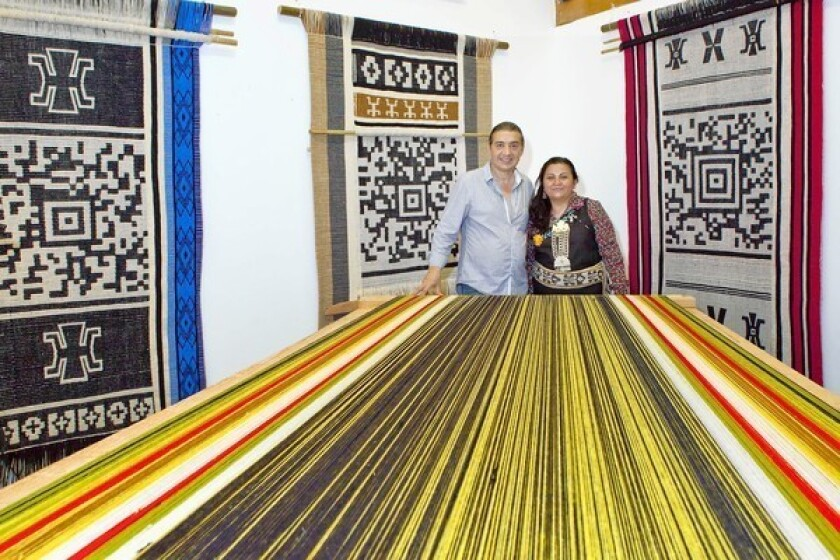 Mapuche tribal traditions embedded in bar-code tapestries