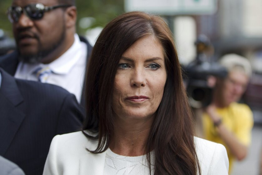 FILE - In this Aug. 8, 2015, file photo, Pennsylvania Attorney General Kathleen Kane arrives to be arraigned on charges she leaked secret grand jury material and then lied about it under oath at the Montgomery County detective bureau in Norristown, Pa. The Pennsylvania Supreme Court's temporary sus