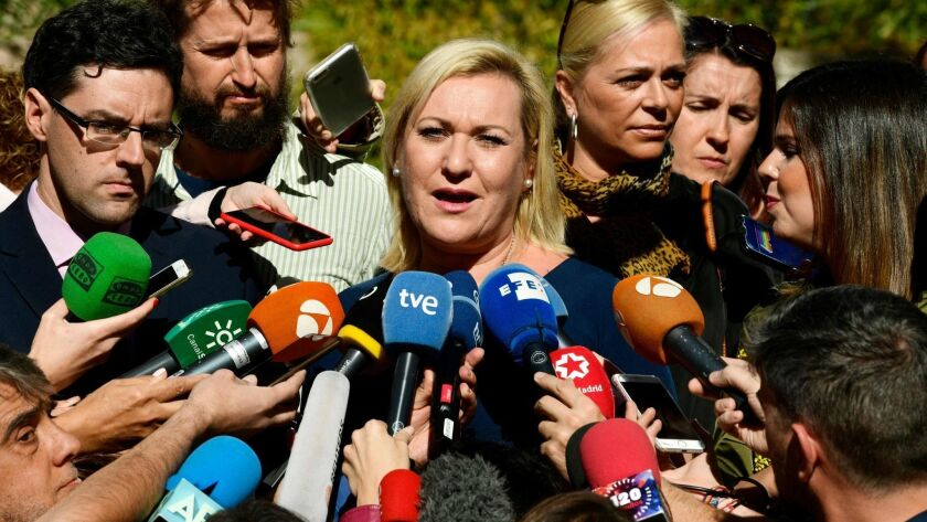 Ines Madrigal speaks to journalists outside a Madrid court after 85-year-old former gynecologist Eduardo Vela was found guilty and then acquitted of abducting Madrigal from her mother as a newborn in 1969.