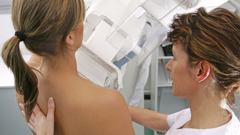 A medical workers administers a mammogram at Rouen University Hospital in France.
