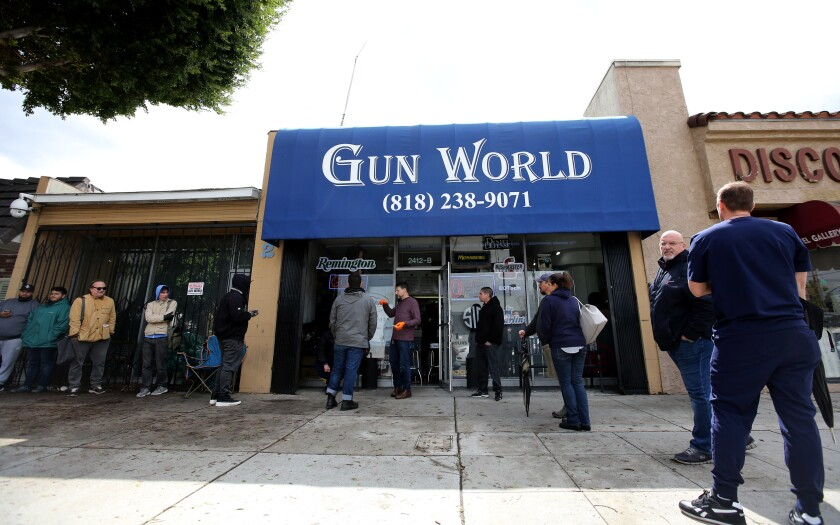 Customers line up outside Gun World on Magnolia Avenue in Burbank on March 17.