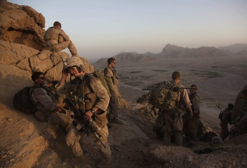 Lance Cpl. Mark Chieffallo of Pittsburg arrives at an observation post on a peak above a village in Helmand province with over Marines.