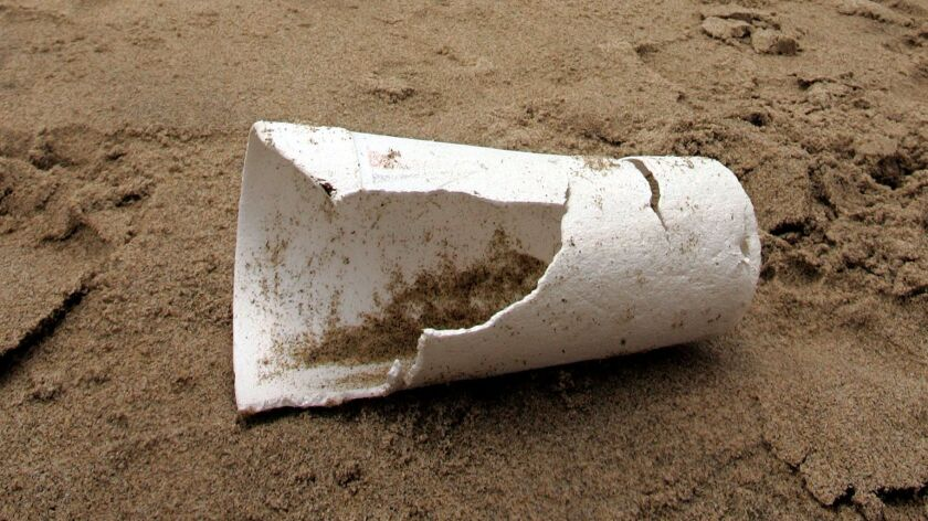 A discarded polystyrene cup lies near the shoreline at Santa Monica Beach in 2006. The Ventura City Council this week voted to ban restaurants from using polystyrene food containers.