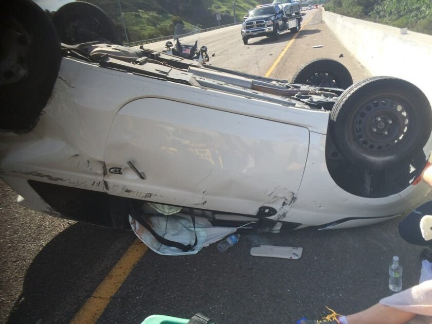 Three people crawled out of this Fiat 500 on I-5 north with only cuts and bruises.