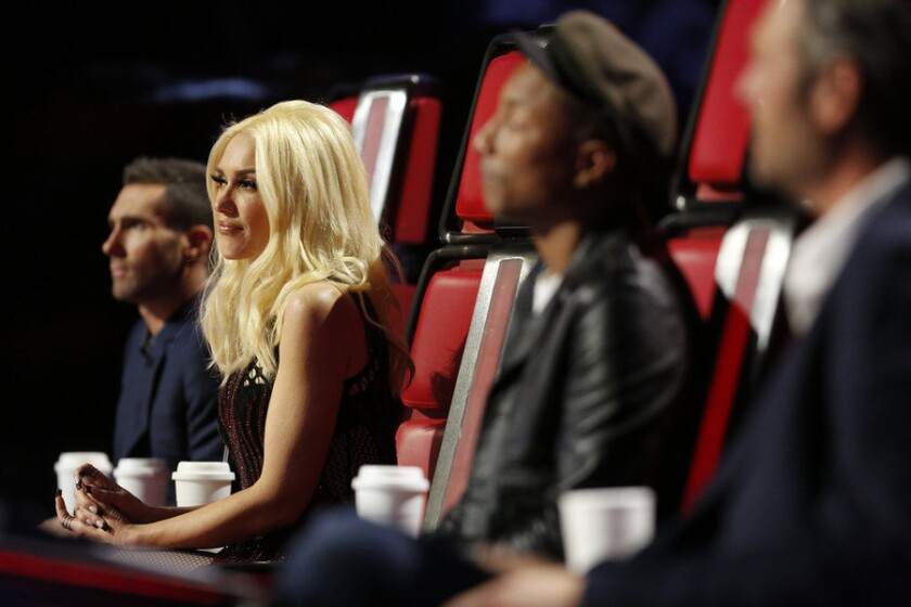 """""""The Voice"""" coaches, from left, Adam Levine, Gwen Stefani, Pharrell Williams and Blake Shelton watch Teams Gwen and Adam perform on the first night of the show's live playoffs."""