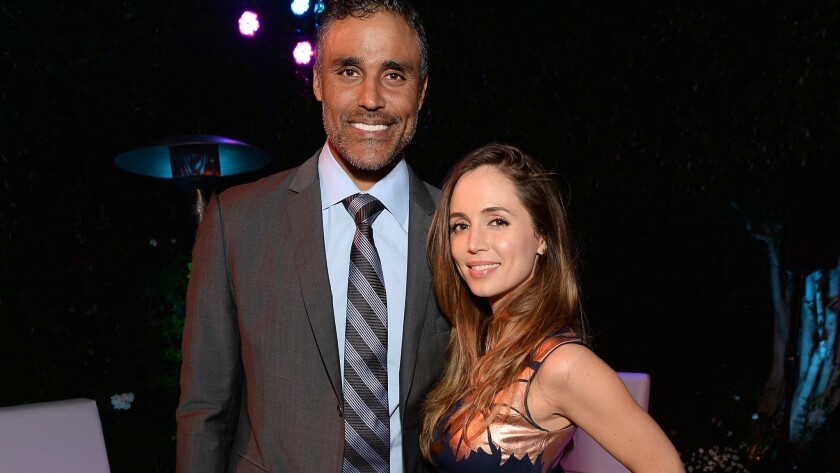 Rick Fox and Eliza Dushku, shown last August, have split after five years together.