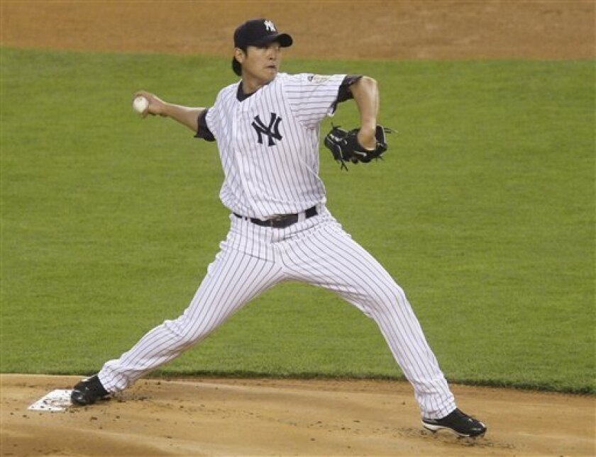 New York Yankees' Chien-Ming Wang delivers against the Seattle Mariners during the first inning in Major League Baseball action Friday, May 2, 2008, at Yankee Stadium in New York. (AP Photo/Julie Jacobson)