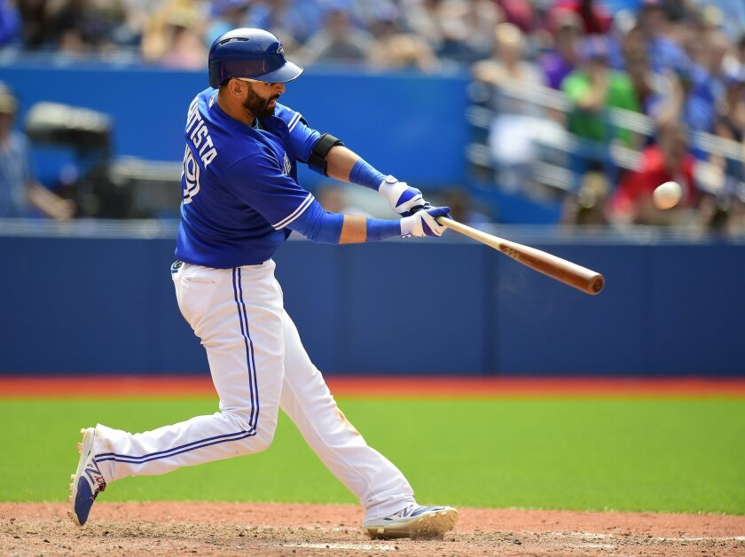 Toronto Blue Jays Jose Bautista slams a two-run home run off Cesar Ramos during seventh inning American League baseball action against the Los Angeles Angels in Toronto, Monday, May 18, 2015. (Frank Gunn/The Canadian Press via AP) MANDATORY CREDIT