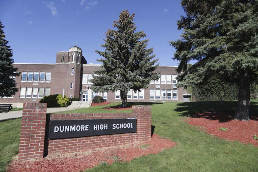 Dunmore High School sign in front of a building