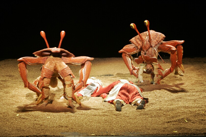 """Crabs spring from the sand in Cirque du Soleil's show """"Ka."""""""