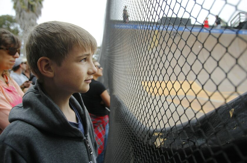 Nick Swafford, 12, watches  the Clash at Clairemont at the Mission Valley YMCA Krause Family Skate & Bike Park in Clairemont.