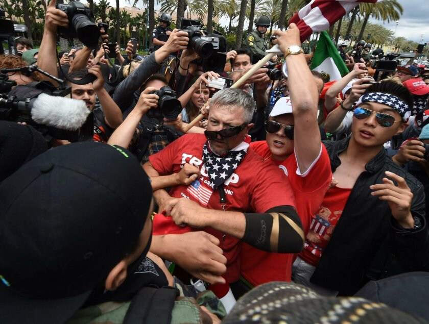 Anti-Trump protesters clash with Trump suporters outside the Anaheim Convention Center during a rally for Republican presidential candidate Donald Trump Wednesday.
