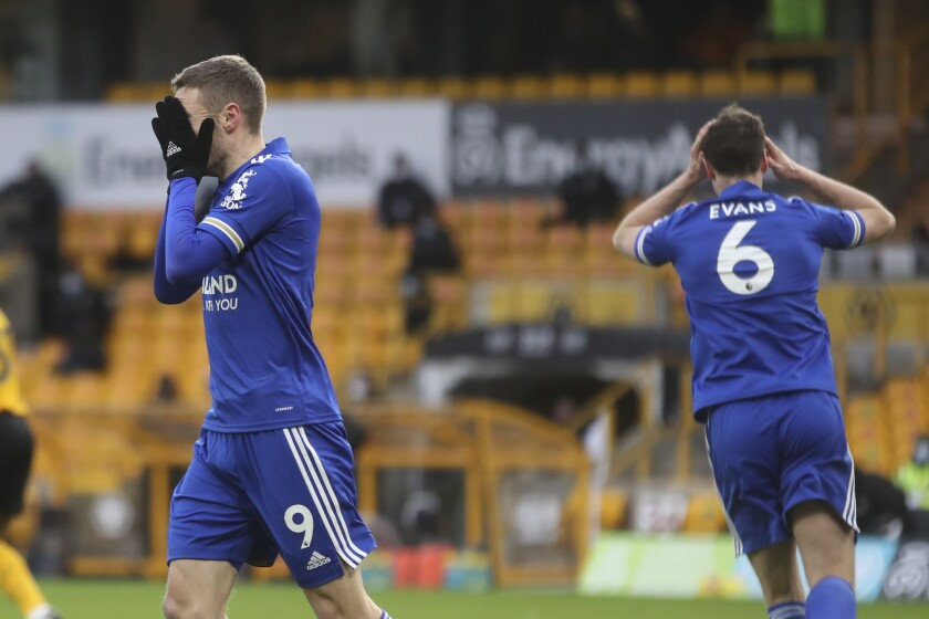 Leicester's Jamie Vardy, left, reacts during the English Premier League match between Wolves and Leicester City at the Molineux Stadium in Wolverhampton, England Sunday, Feb. 7, 2021. (Carl Recine/Pool via AP)