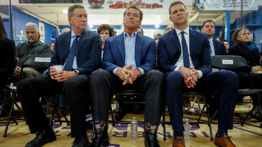 Former Gov. Arnold Schwarzenegger, center, Ohio Gov. John Kasich, left and Assemblyman Chad Mayes (R-Yucca Valley) at an event to debut a new group trying to reform the California Republican Party.
