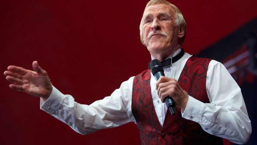 British TV entertainer Bruce Forsyth gestures to the crowd while performing at the Glastonbury Festival of contemporary performing arts in 2013.