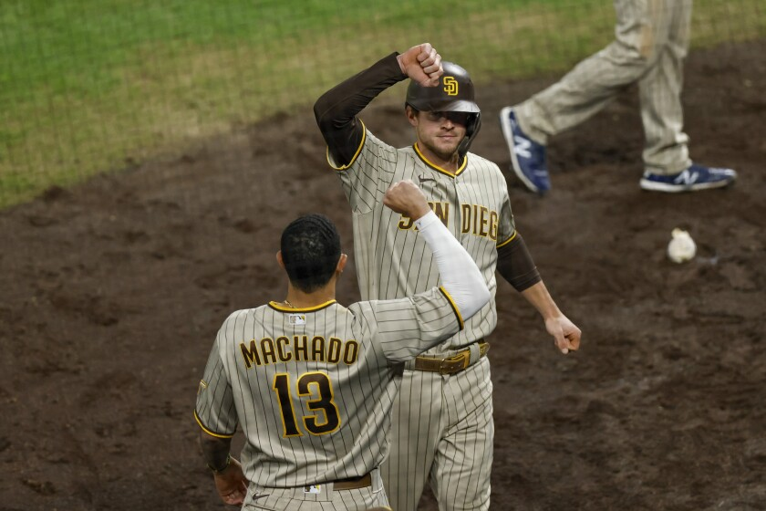 Wil Myers of the Padres is congratulated on his solo home run by Manny Machado last weekend in Denver.