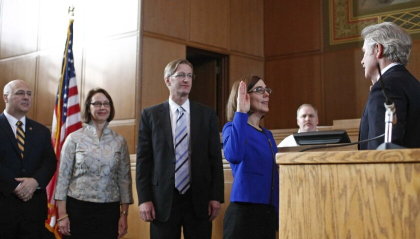 Secretary of State Kate Brown takes the oath of office from Gov. John Kitzhaber at the Oregon Capitol in Salem on Jan. 4.