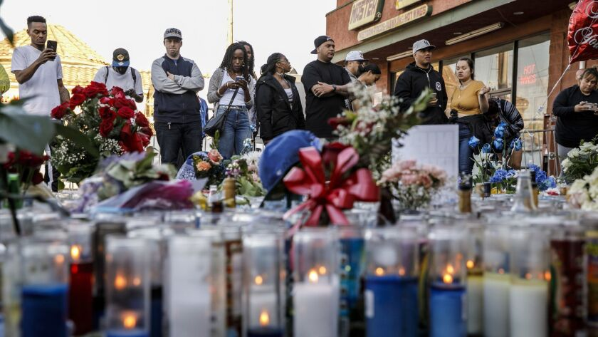 LOS ANGELES, CALIF. -- TUESDAY, APRIL 2, 2019: Community members pay their respects to the slain Nip