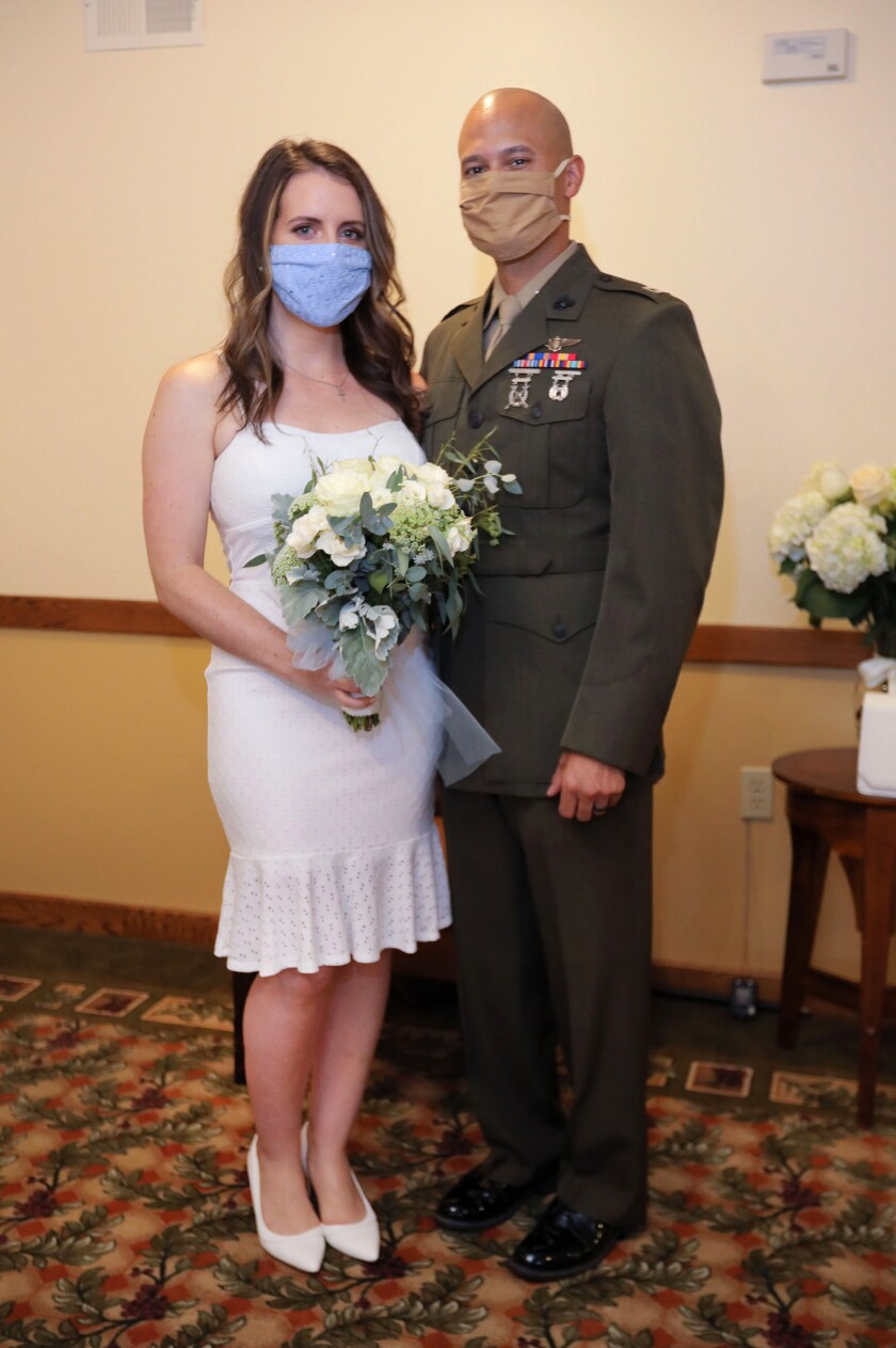 Portrait of Amber Cross, 26, and Daniel Jackson, 31, after their wedding ceremony at Cypress Court retirement community.