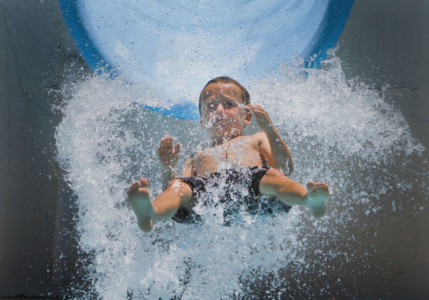 Children cool–off at Wild Rivers in Irvine in 2011. Construction of a new Wild Rivers park began Wednesday.