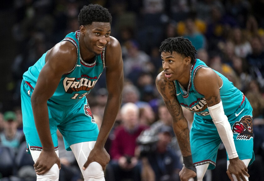 Grizzlies forward Jaren Jackson Jr. (13) and guard Ja Morant chat during a break in action during a game against the Lakers on Nov. 23, 2019, in Memphis, Tenn.