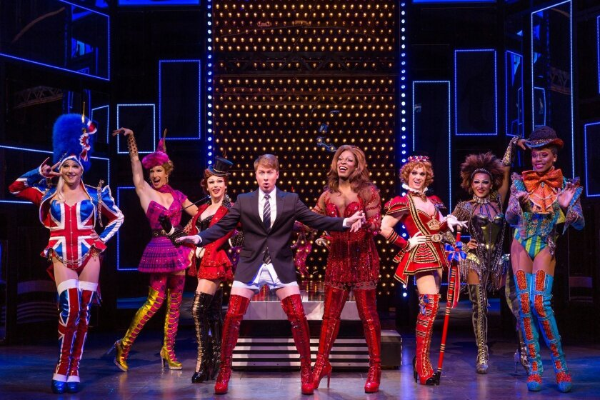 "Steven Booth (center left), Kyle Taylor Parker (center right) and the ""angels"" in the touring production of ""Kinky Boots."""