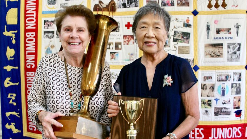 Ruth Sowby Rands, Glendale News-Press columnist, awards the Glendale News-Press Perpetual Trophy for