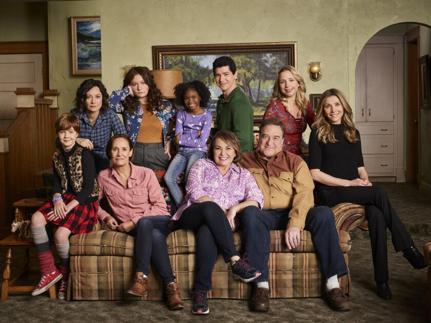 """The cast of ABC's """"Roseanne,"""" from left, Ames McNamara as Mark, Sara Gilbert as Darlene Conner, Laurie Metcalf as Jackie Harris, Emma Kenney as Harris Conner, Jayden Rey as Mary, Roseanne Barr as Roseanne Conner, Michael Fishman as D.J. Conner, John Goodman as Dan Conner, Lecy Goranson as Becky Conner, and Sarah Chalke as Andrea."""