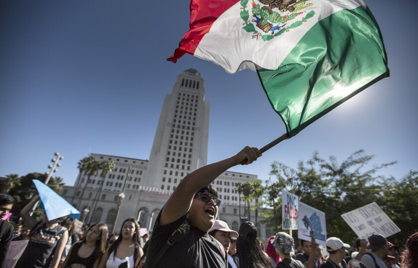 Hundreds of Los Angeles-area students walk out of their classrooms and converge on City Hall in downtown Los Angeles to protest Donald Trump's election as president last month.