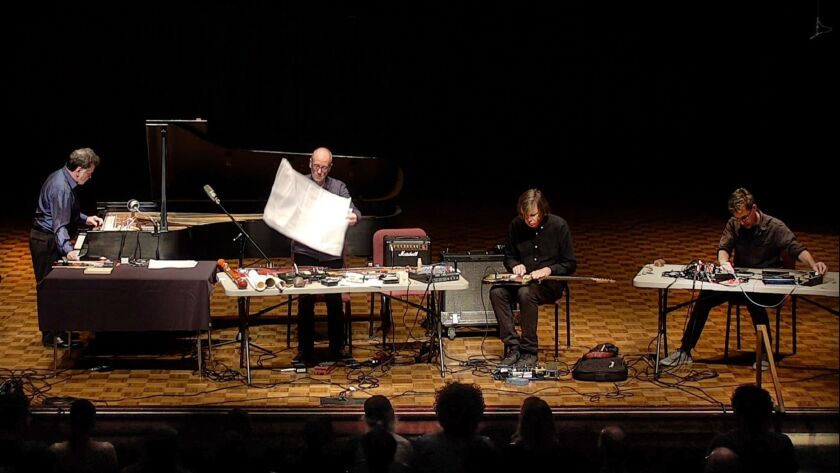 """Interpreting John Cage's """"Electronic Music for Piano"""" are Gino Robair, from left, on piano and electronics; David Toop, resonance, secondary amplification, swallowed instruments, and feedback; Thurston Moore, electric guitar; Jon Leidecker, mobiles and mixer."""