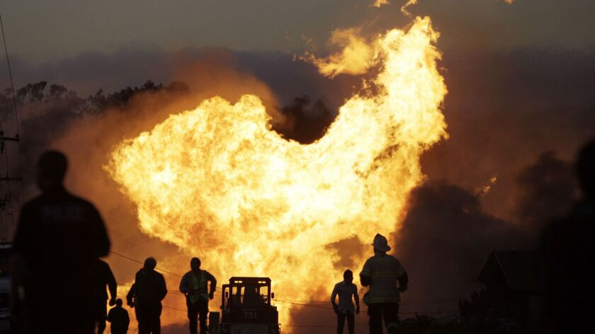 FILE - In this Sept. 9, 2010, file photo, a massive fire from a pipeline explosion roars through a n