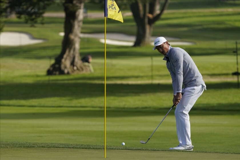 Haotong Li of China chips to the green on the seventh hole during the second round of the PGA Championship.