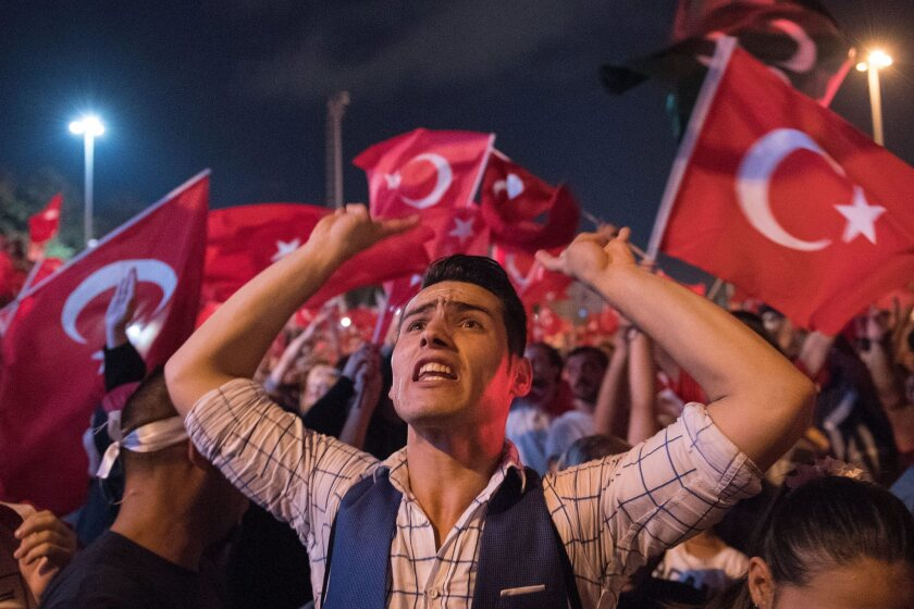 At Taksim Square in Istanbul, Turkey, demonstrators express support for the government on July 17, 2016, after the failed coup attempt.