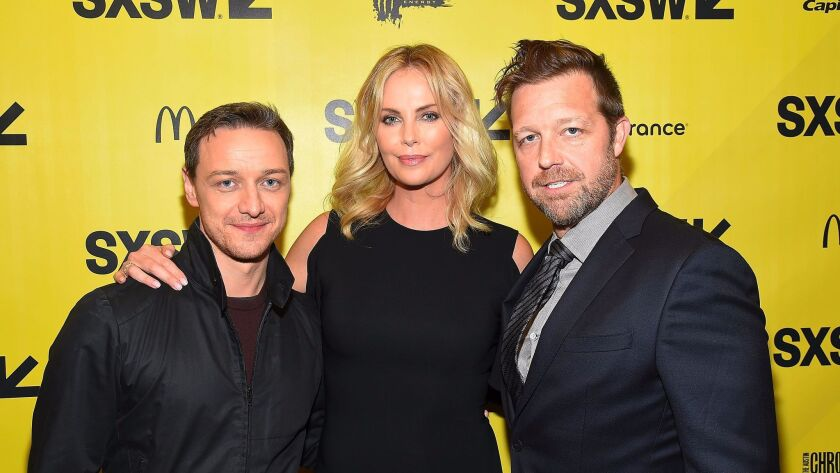 "James McAvoy and Charlize Theron join director David Leitch, right, at the ""Atomic Blonde"" premiere at SXSW in Austin."
