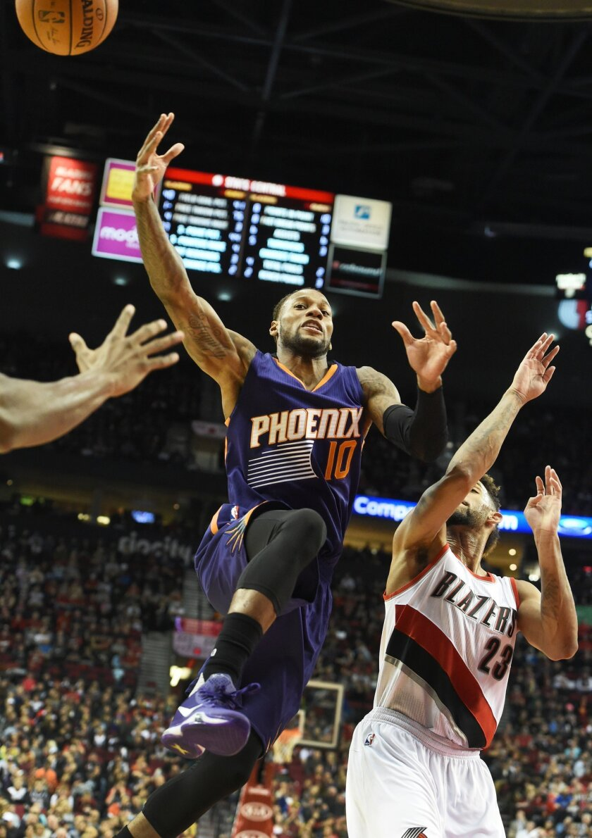 Phoenix Suns guard Sonny Weems (10) drives to the basket on Portland Trail Blazers forward Allen Crabbe (23) during the first quarter of an NBA basketball game in Portland, Ore., Saturday, Oct. 31, 2015. (AP Photo/Steve Dykes)