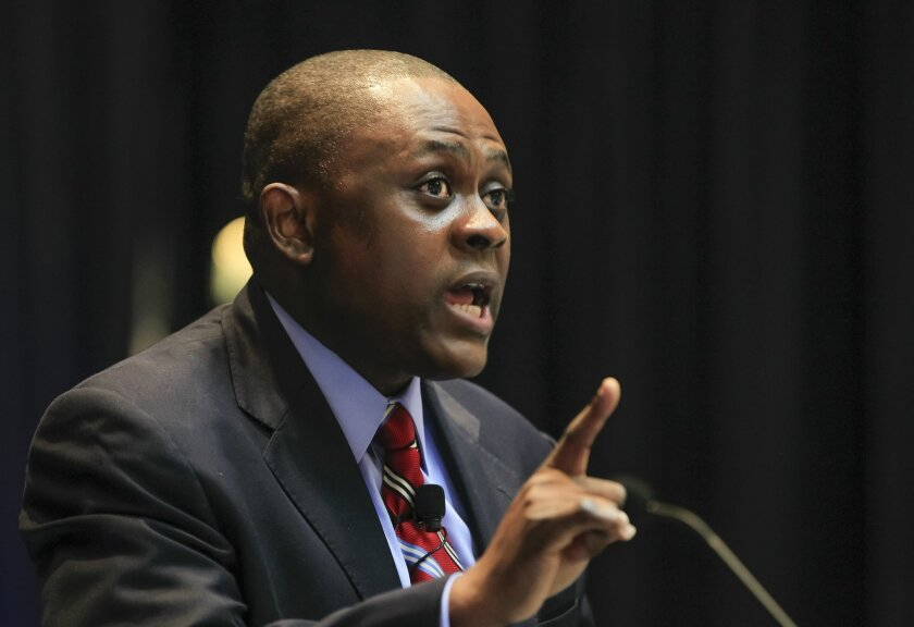 A passionate Dr. Bennet Omalu gives the keynote speech at the 11th Annual Brain Injury Rehabilitation Conference on Friday at the Liberty Station Conference Center in San Diego, California.