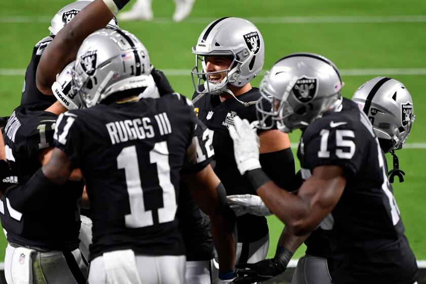 Las Vegas Raiders quarterback Derek Carr celebrates with his teammates.