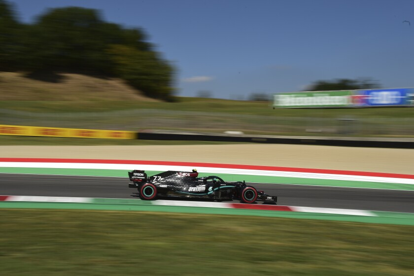Mercedes driver Valtteri Bottas of Finland steers his car during the third practice session ahead of the Grand Prix of Tuscany, at the Mugello circuit in Scarperia, Italy, Saturday, Sept. 12, 2020. The Formula One Grand Prix of Tuscany will take place on Sunday. (AP Photo/Luca Bruno, Pool)